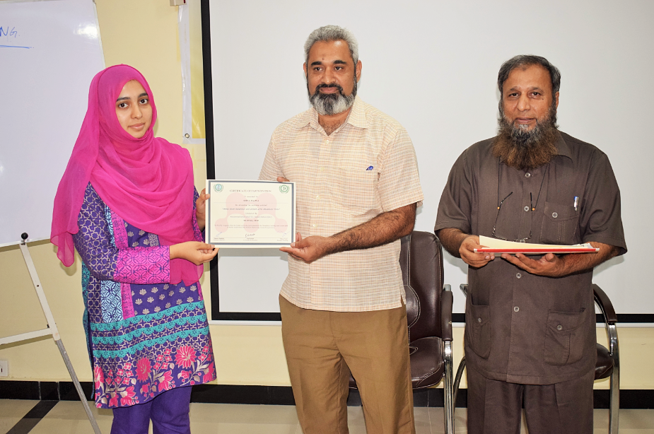 Participant receiving certificate on closing ceremony of 'Training Workshop on Citation Management using Mendeley Software' at PASTIC, Islamabad. (19<sup>th</sup>, July 2018)
